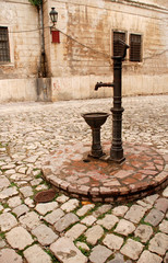 Vintage water well in a medieval town in Kotor