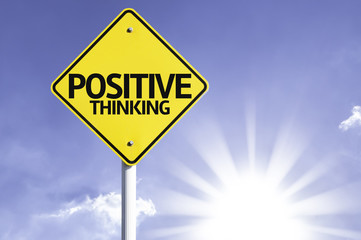 Positive Thinking road sign with sun background