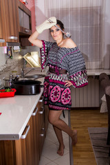Cheerful young woman in the mood modern kitchen