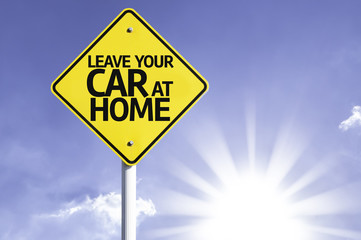 Leave your Car at Home road sign with sun background