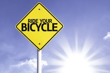 Ride your Bicycle road sign with sun background