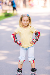 Little girl rollerskating in the park