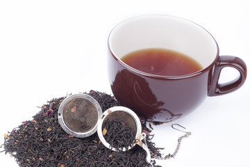 black tea and a cup of tea on a white background