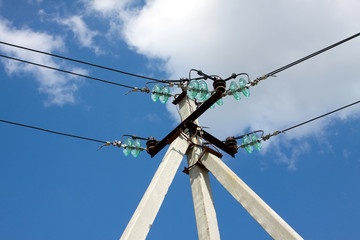 Prop top of power supply line over blue sky with white clouds