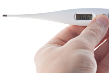 Hand holding electronic thermometer