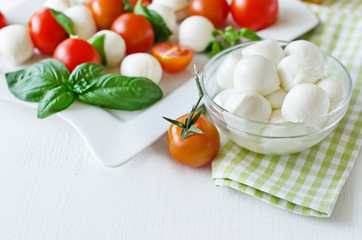 Mozzarella balls with basil, tomatos and balsamic, caprese