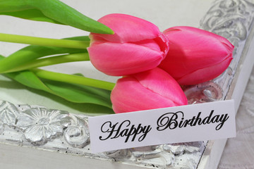Happy birthday card with three pink tulips