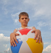 Young boy with beach ball