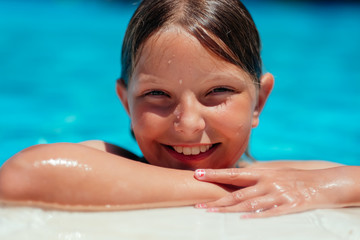 Smiling girl at poolside