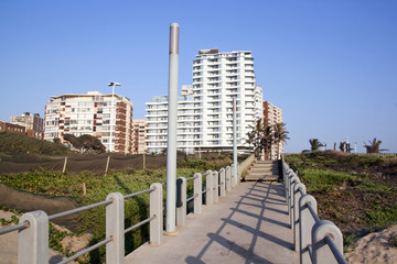 Walkway Leading from Beach with Residential Buildings in Backgro