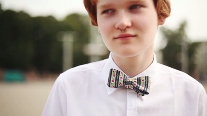 Street Fashion. Cute  red-haired Boy with butterfly.