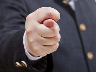 businessman holds fig sign close up