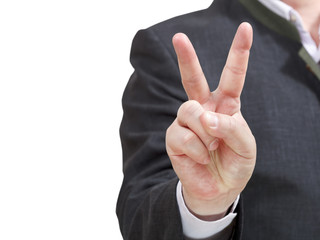 businessman holds victory sign - hand gesture