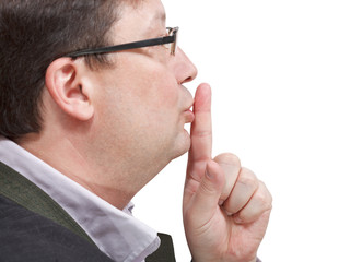 side view of businessman's finger near lips
