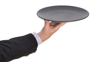 above view of hand with empty flat black plate