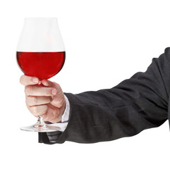 toast withred wine glass in businessman hand