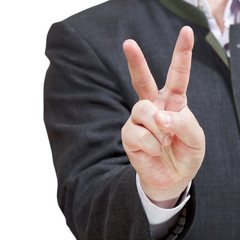 businessman shows victory sign - hand gestur
