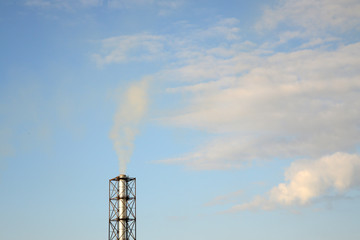 smoke from a chimney on a blue sky