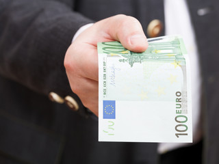 front view of 100 euro banknote in hand close up