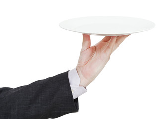 hand with empty flat white plate