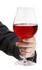front view of red wine glass in businessman hand