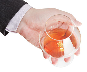 above view of cognac glass in businessman hand