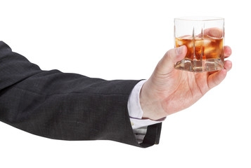side view of whisky glass in businessman hand