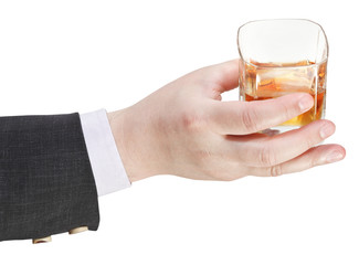 whisky glass in businessman hand