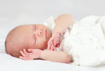 beautiful baby girl sleeping, three weeks old
