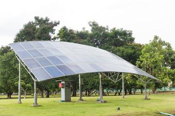 Solar panels on green grass field