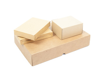 Small brown cardboard boxes stacked on top large box.