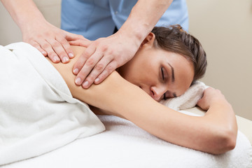 Lady having back massage