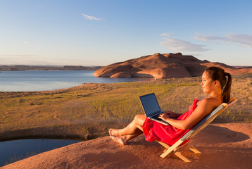 Girl with Computer at Lake Powell Sunrise
