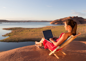 Girl Working on Computer at Sunrise at Lake Powell