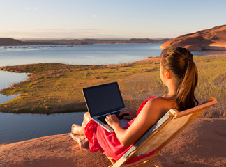 Girl Working with Computer at Lake Powell