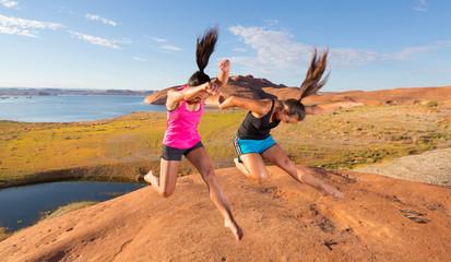 Pair of Girls Jumping for Joy