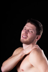 Man with strong shoulder pain