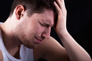 Man with strong migraine