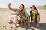 family taking a self portrait at the beach