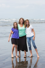 Mother and daughters at beach