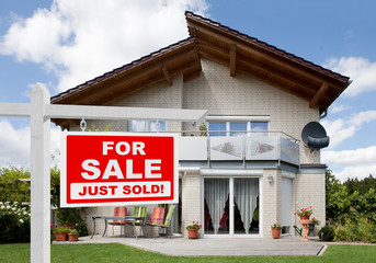 Sold Home For Sale Sign In Front Of House