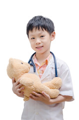 Asian doctor boy holding bear toy isolated on white background