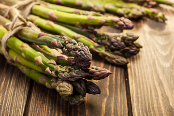 Bunch of young asparagus on wooden table