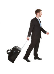 Businessman With Luggage Walking Over White Background