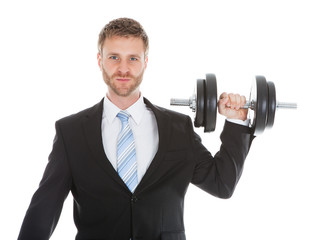 Confident Businessman Lifting Dumbbell