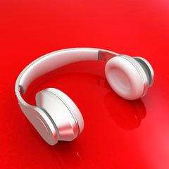 White headphones isolated on a red background