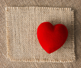 Red heart on burlap, sackcloth background. Valentines Day
