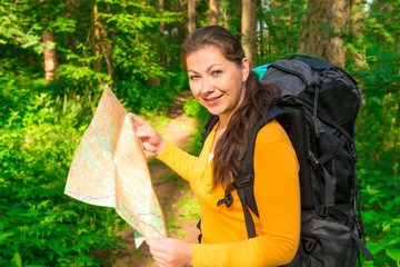 tourist with backpack and map smiling