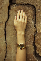 Luxurios accessory concept. Young woman's hand with wrist-watch