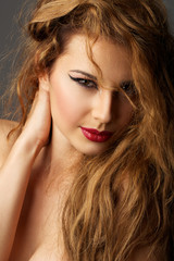 passionate Russian girl with red hair and alluring eyes